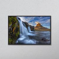 The mountain kirkjufell and waterfall kirkjufellsfoss on the snaefellsnes peninsula; grundarfjorour