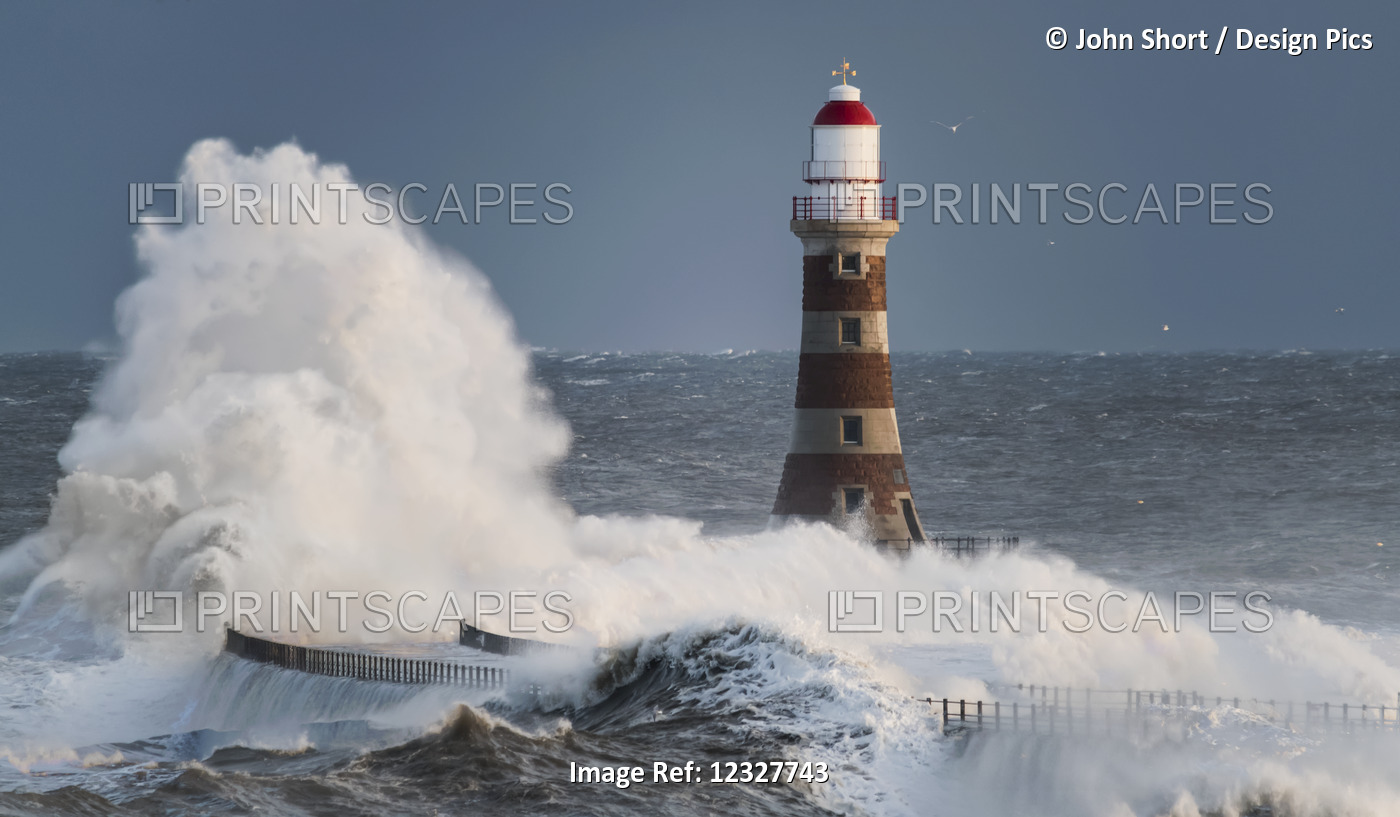 Waves Splashing Against Roker Lighthouse At The End Of A Pier; Sunderland, Tyne ...