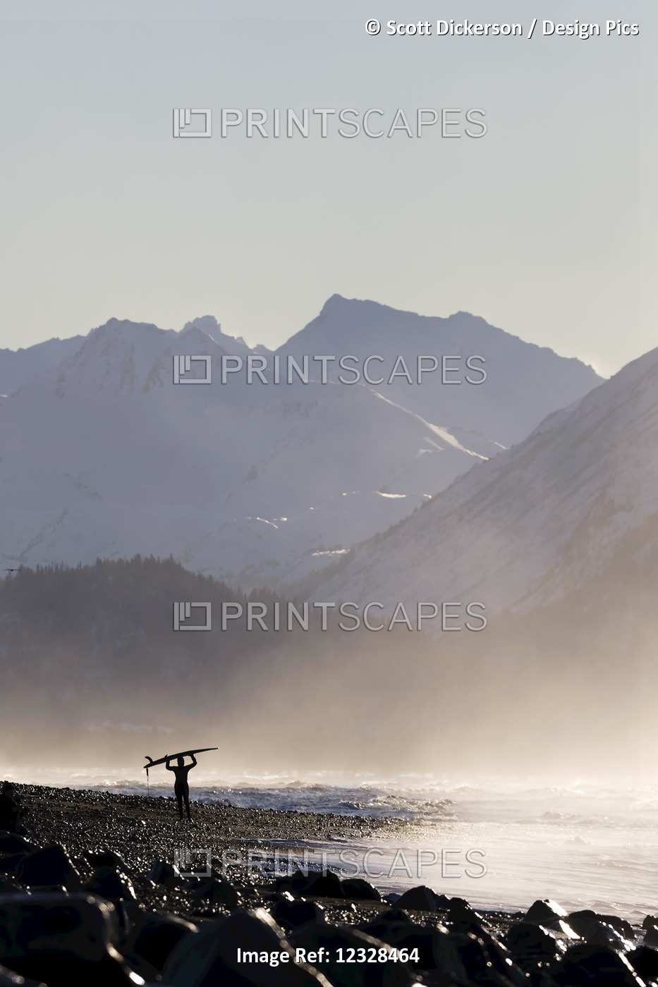 A Surfer Carries Her Surfboard Across The Beach In The Mist Along The Coast; ...